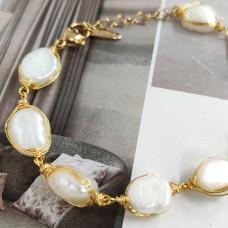 Armbånd med perler med guld